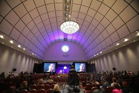 Convention-goers watched a presentation sponsored by the New Orleans tourism bureau in a ballroom at the Hynes.