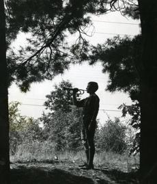 July 12, 1961: Bugler Stewart K. Jackson of Troop 55 in Swampscott signaled the end of the day by playing taps at Camp Powow in Amesbury. Boy Scouts of the Bay Shore Council got close to nature at the pine covered seven-acre tract where, during summer sleep-away camp sessions, scouts put their scouting skills to good use.