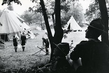 July 24 1961: Bill Milne, age 6 on the left, and Russell Dorman, Scout leader, watched the activity at a Sudbury camp-out for American and Canadian Boy Scouts.