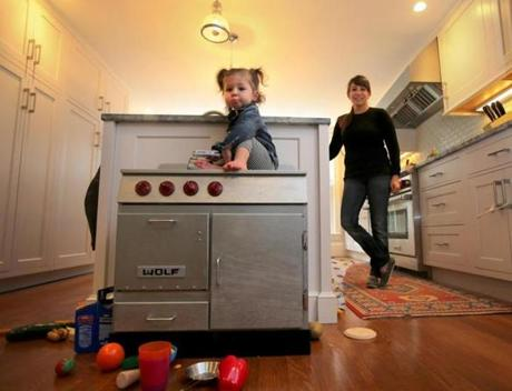 Rebecca Roth Gullo of The Gallows restaurant at home with her 16-month-old daughter, Gigi.