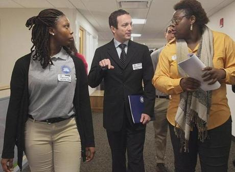 Thammy Pierre-Louis (left) and Porsha Olayiwola accompanied French Consul General Fabien Fieschi during a tour of Codman Academy in Dorchester on Wednesday.