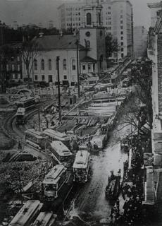 The city managed to keep its busiest thoroughfares open to traffic. Rather than eliminate street-level rail service, engineers took the extraordinary step of designing a detour of the tracks.