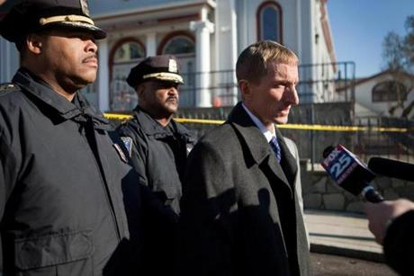 Boston Police Commissioner William Evans spoke outside the Dorchester apartment building.