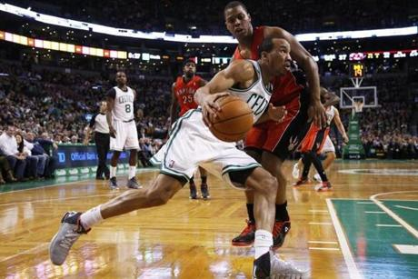 Avery Bradley drove along the baseline and scored against Raptors guard Kyle Lowry in the second quarter.