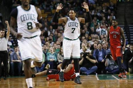 Jared Sullinger held up his hands after fouling Kyle Lowry.