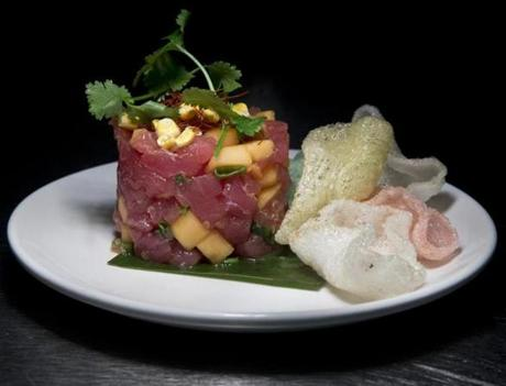 Tuna tartare, accompanied by melon, lemongrass, chile threads, and shrimp chips.