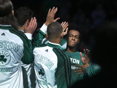 Boston, MA - 01/17/14 - (1st quarter) Boston Celtics point guard Rajon Rondo (9) high fives his teammates as he is introduced at the start of the game. Boston Celtics point guard Rajon Rondo (9) returns to action against the Los Angeles Lakers at TD Garden in his first game back since suffering a season ending knee injury in 2013. - (Barry Chin/Globe Staff), Section: Sports, Reporter: Washburn, Topic: 18Celtics-Lakers, LOID: 7.2.4103920098.