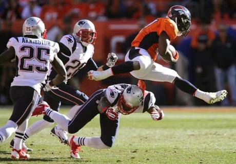 Knowshon Moreno leaped over Duron Harmon, breaking loose for a long gain.