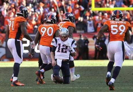 The Broncos celebrated Knighton sacking Brady.