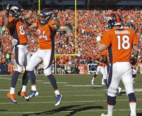 Eric Decker (left) celebrated with teammate Tamme after Tamme's 1-yard touchdown reception.