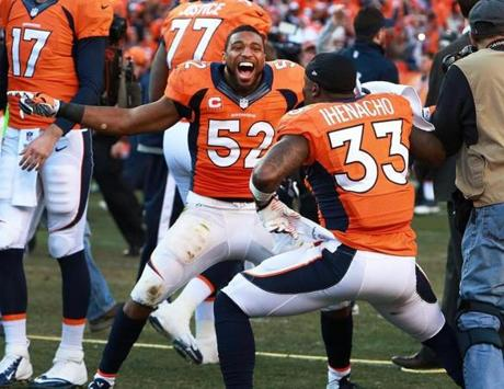 Wesley Woodyard (left) and teammate Duke Ihenacho were jubilant over the Broncos' win.