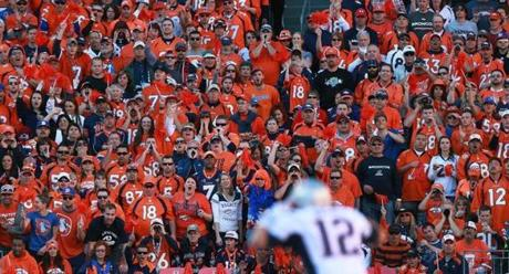 01/19/14 Denver, CO: Patriots quarterback Tom Brady (foreground right) tries to bark out signals despite the screams of the very loud Broncos fans. The New England Patriots visited the Denver Broncos for the AFC Championship Game at Sports Authority Field at Mile High. (Globe Staff Photo/Jim Davis) section:sports topic: Patriots-Broncos (1)