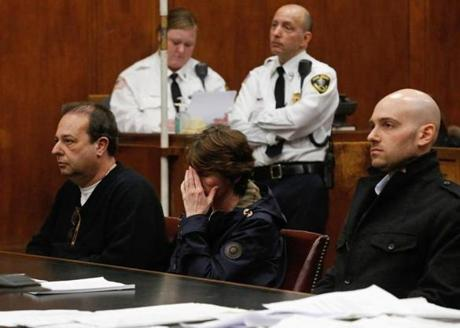 (L-R) Steven Palladino his wife, Lori, and son Gregory plead guilty to a ten million dollar ponzi scheme at Suffolk Superior Court in Boston, Massachusetts January 21, 2014. (Jessica Rinaldi For The Boston Globe)