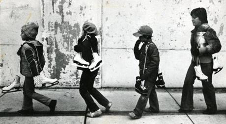 November 12, 1979: Headed home were Joy Romano, 7. Jennifer Alessandro, 7 and Thomas Alessandro, 7, and Donna Alessandro. All of the North End, they walked home after a session of ice skating at the MDC's Steriti Memorial rink on Commercial Street.