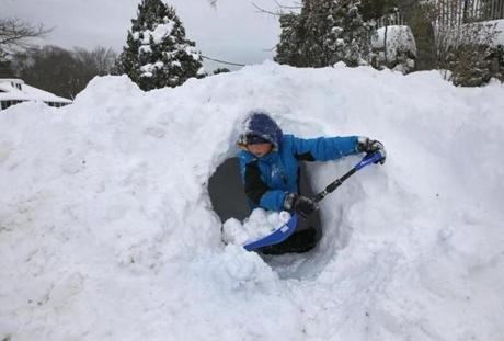 HANOVER, MA , 01/ 22 / 14: Record snowfall helped Tanner Paul ( cq) 10 yrs old build a fort in the snow in Hanover. Snow conditions on the South Shore area got snow heights up to 17 plus inches ( David L Ryan/Globe Staff Photo ) SECTION: METRO TOPIC 23storm(1)
