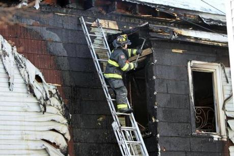 Jan 23, 2014 --Somerville, MA - Firefighter checks for hotspots after a fire broke out in a Somerville multifamily home on Mt. Vernon St., no injuries, cause unknown. (globe staff photo; Joanne Rathe reporter: section:met topic: STAND ALONE )
