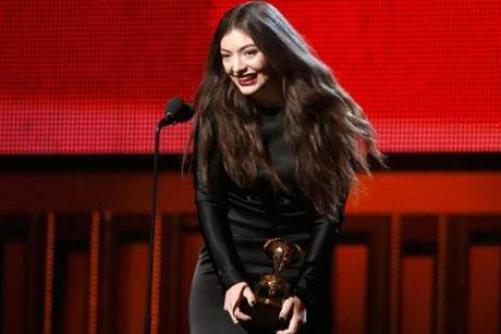 Lorde holds her trophy for best pop solo performance.