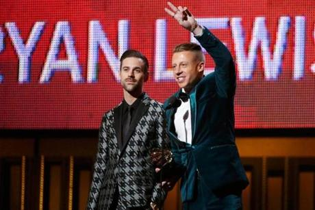 Ryan Lewis and Macklemore win the award for best new artist.
