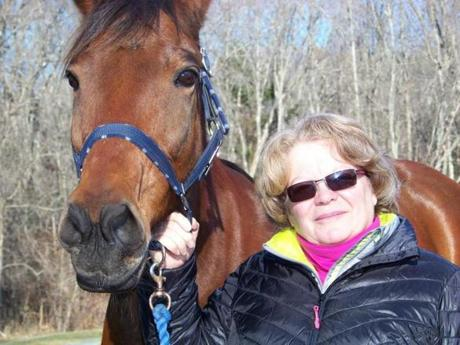 Caroline Matterson and her standard bred horse, Clint, in her backyard.