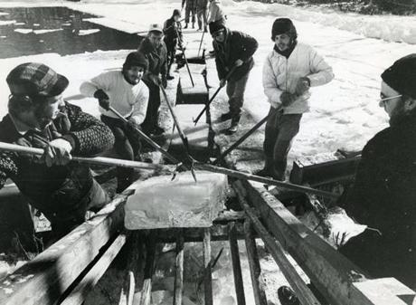 A block heads toward the ice house in 1974 in Maine, where ice harvesting has survived as a community tradition.