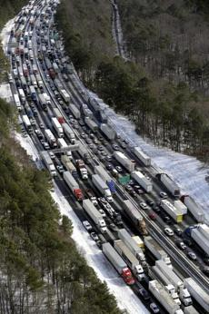 Roads around Atlanta were still snarled Wednesday. Many people slept in cars overnight.