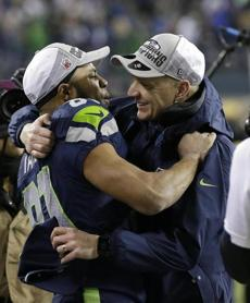Seahawks receiver Golden Tate embraced offensive coordinator Darrell Bevell after Seattle captured the NFC championship on Jan. 19.