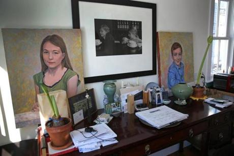 Her room is decorated with paintings of her children.
