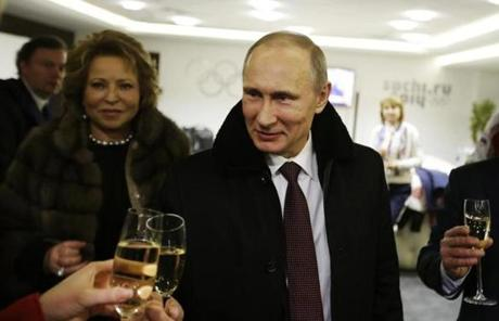 Putin toasts guests in the presidential lounge after the ceremony.