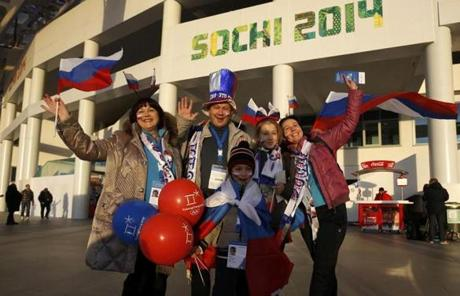 People waved before the Opening Ceremony.