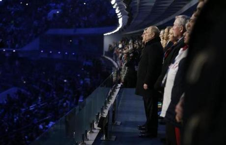 Russian President Vladimir Putin stood during the playing of the Russian national anthem.