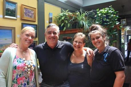 Mad Batter owners Mark Kulkowitz and Pamela Huber (center) with daughters Marta (left) and Tessa Kulkowitz.