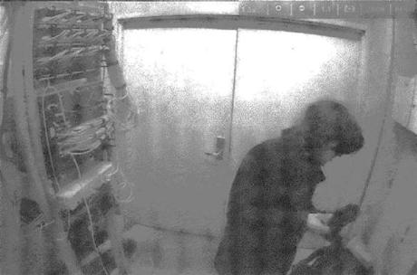 A series of images taken from video footage allegedly shows Aaron Swartz in a wiring closet at MIT on Jan. 4, 2011.