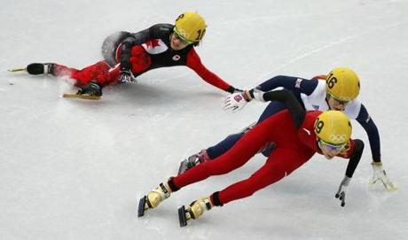 Canada's Jessica Hewitt (left) takes a slip during the women's 500-meter short-track speedskating.