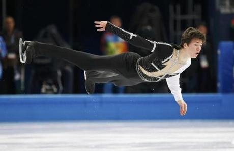 Ukraine's Yakov Godorozha whirls over the ice during the men's short program.