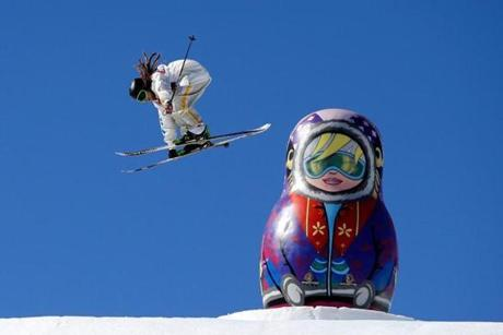 Freestyle skier Henrik Harlaut of Sweden soars past a Russian ornament in the slopestyle finals.