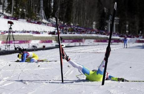 Slovenia's Barbara Jezersek (right) and Ukraine's Marina Lisogor are spent after the 10k cross-country race.