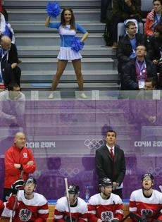 US-style cheerleaders worked the crowd behind Austria's bench during hockey vs. Finland.
