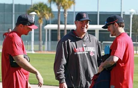 Pierzynski (left) and pitcher Jake Peavy (right) had a laugh with manager John Farrell.