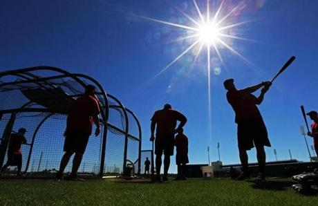 The sun shone in a bright blue sky as players worked out informally before the official start of Spring Training.