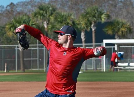 Daniel Nava threw the ball against a backdrop of palm trees.