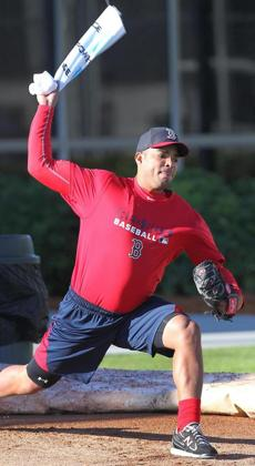 Pitcher Dalier Hinojosa, a non-roster invitee from Cuba, used a towel as he worked on his motion in the bullpen.