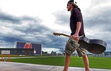 Clay Buchholz arrived with his guitar.