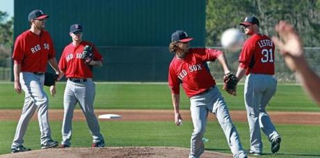 John Lackey, Jake Peavy, Clay Buchholz, and Jon Lester took part in a fielding drill.