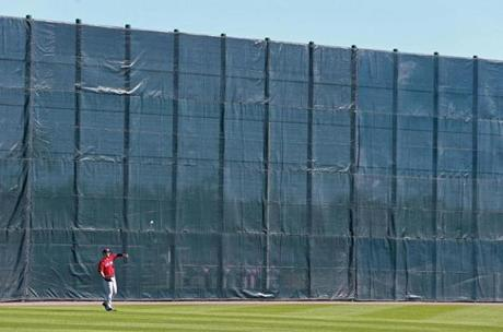 One of the practice fields has a wall meant to replicate the height of Fenway Park's Green Monster, and it dwarfed outfielder Grady Sizemore.