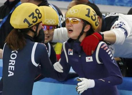 South Korea's Shim Suk Hee (right) and Park Seung-Hi (left) rejoice after winning the women's 3,000 meter relay in short-track.