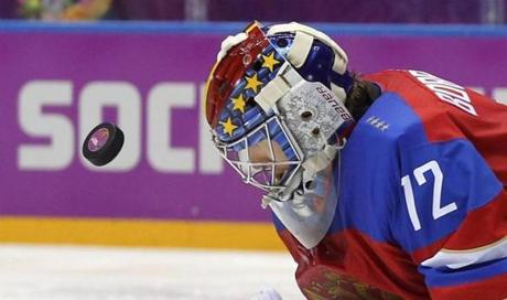 Russian goalie Sergei Bobrovsky has a good view of the puck after making a save against Norway.