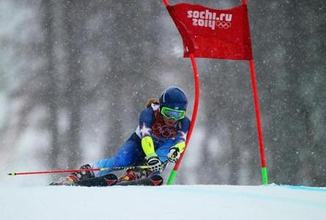 American Mikaela Shiffrin brushes a gate as she whizzes downhill in the giant slalom.