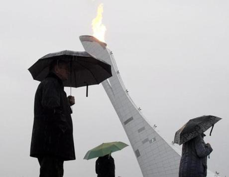It was damp and dreary for much of the day, but the Olympic torch burned on.