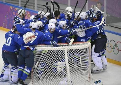 The upstart Slovenia men's hockey team joyously celebrated a win over Austria that kept them alive in the tournament.