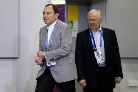 Two figures familiar to North American sports fans -- NHL commissioner Gary Bettman (left) and NHL Players Association head  Don Fehr -- were on hand for a hockey press conference.